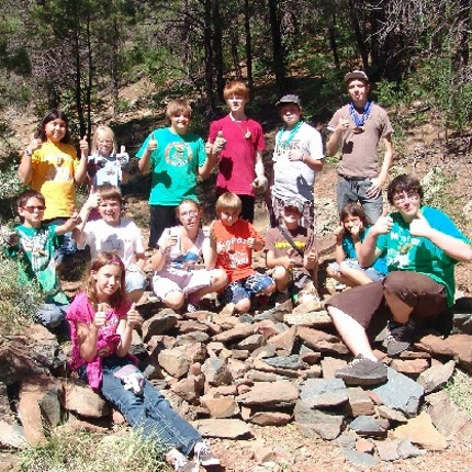 Youth give back to the camp and its natural surroundings through service learning projects, like building gabion dams to prevent soil erosion in the watershed. (Photo courtesy of Arizona 4-H Youth Development)