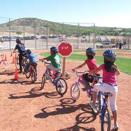 Youth participate in bike rodeo, a district-wide event held at Rio Rico High School. (Photo by Sarah Prasek)