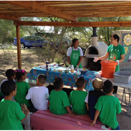 "High school students trained as ""4-H Healthy Living Ambassadors"" led an educational program at Tucson Village Farm with kindergarten students. (Photo: Kirk Astroth)"