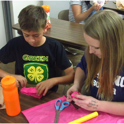 Paper rockets. Five straws. Four cotton balls. Rubber bands. With the simplest materials, 4-H youth participating in the 2014 4-H National Youth Science Day experiment will learn about aerospace engineering, mathematics, trajectory physics and nutrition. (Photo by Kirk Astroth)